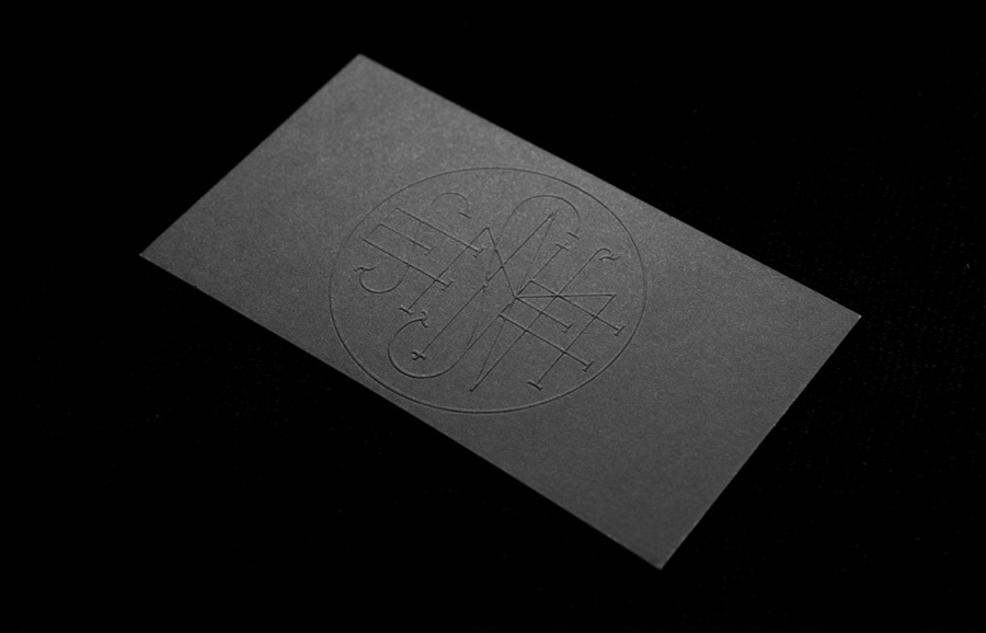Logo and business card with a black board and blind embossed detail designed by Anagrama for Latin American horror film production company Nemesis Films