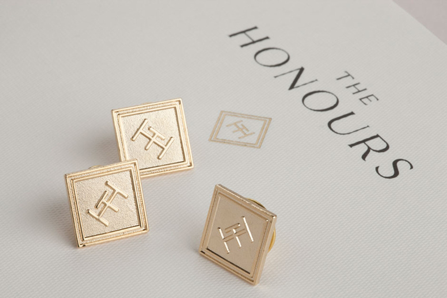 Logo and lapel pins for brasserie The Honours designed by Touch