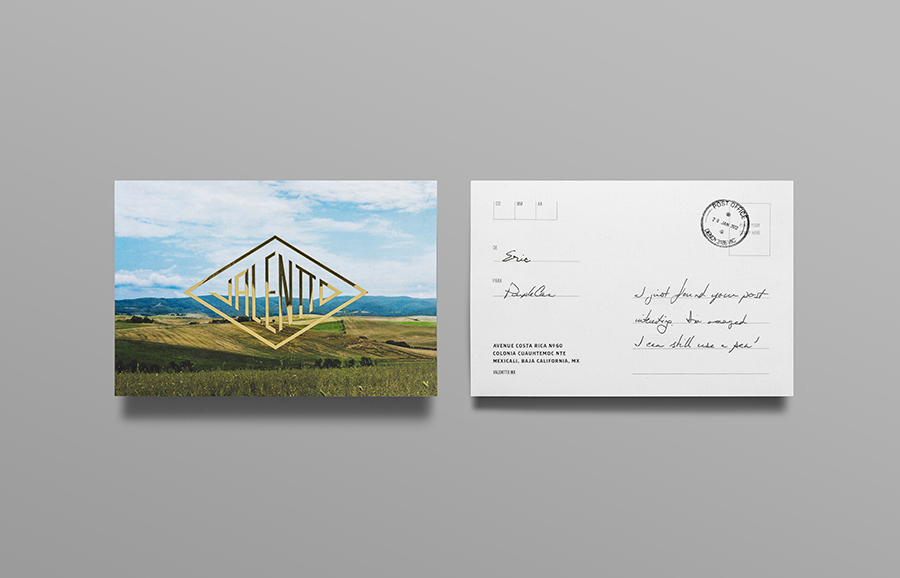 Logo and postcard with gold foil, photographic landscape and stamp detail designed by Anagrama for olive oil brand Valentto
