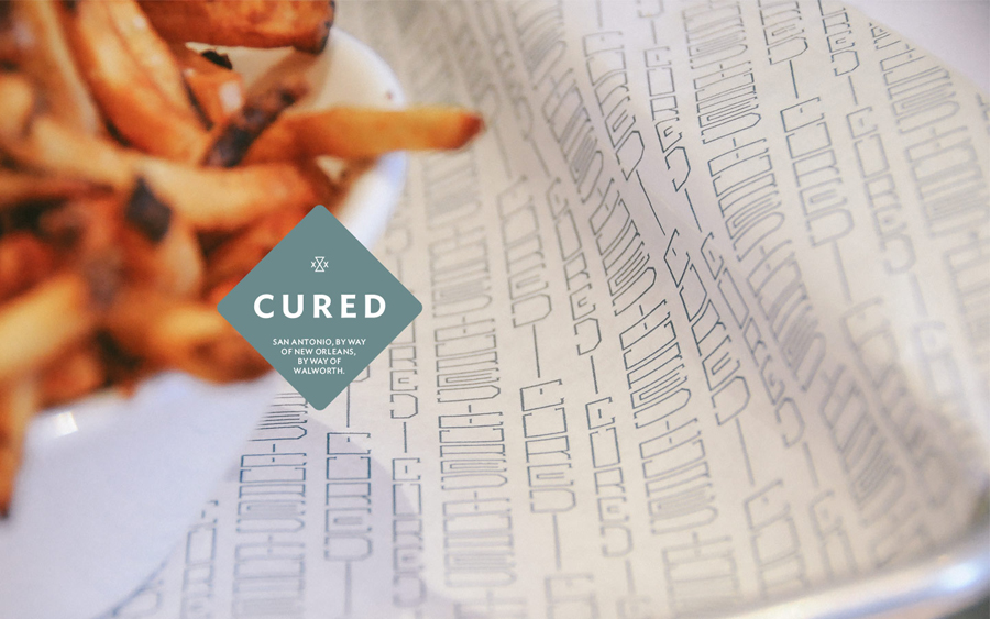 Brand identity and print designed by Föda for San Antonio restaurant Cured