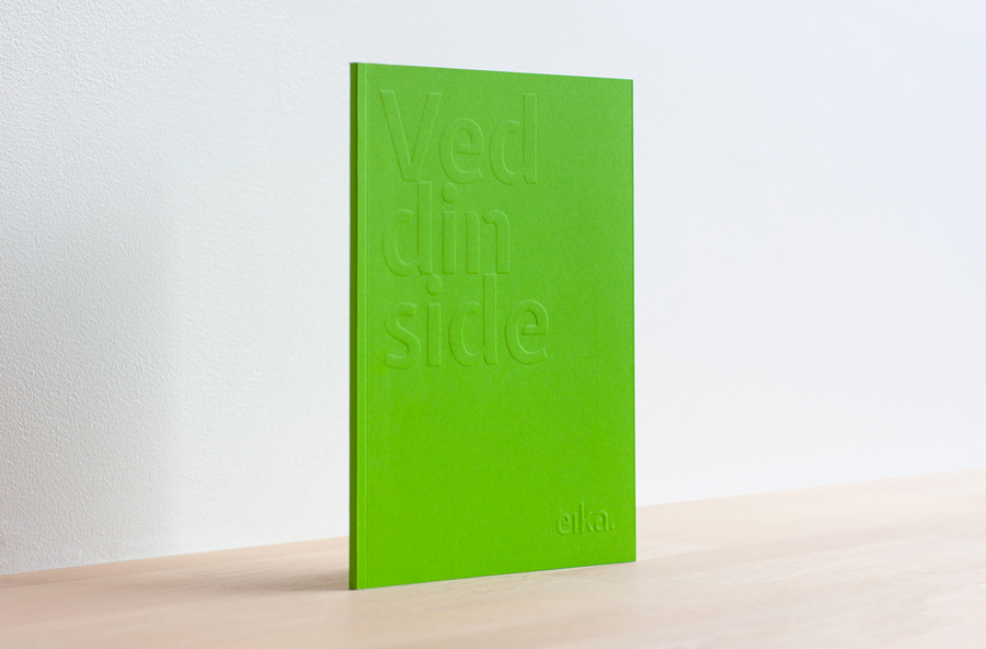 Brand book with green spot and blind emboss detail designed by Mission for local bank alliance Eika