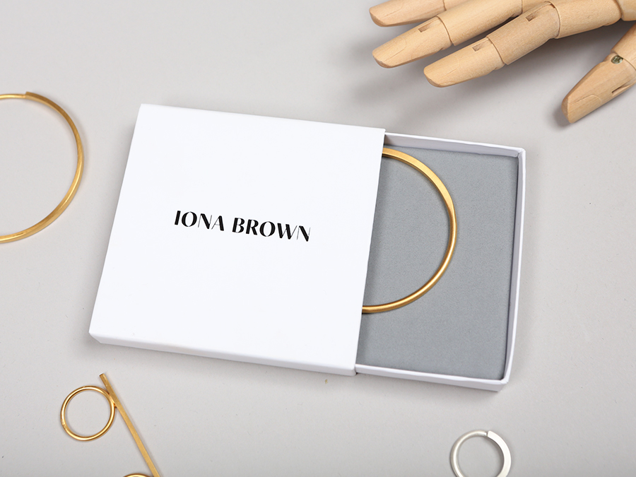 Packaging with black block foil and Colorplan paper for contemporary jewellery designer Iona Brown designed by Sam Flaherty
