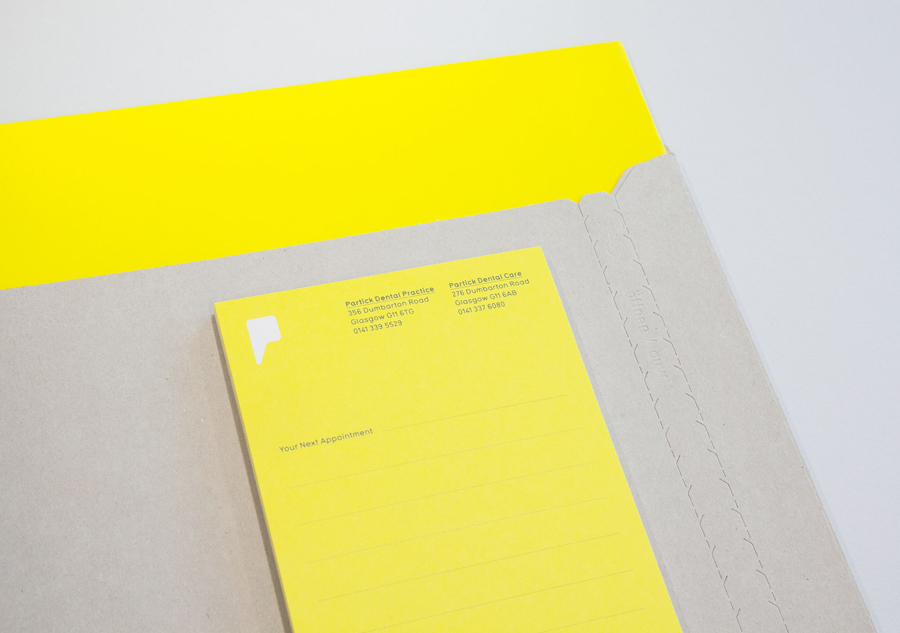 Logo and stationery with yellow and grey paper and board detail designed by Freytag Anderson for Partick Dental featured on BPO