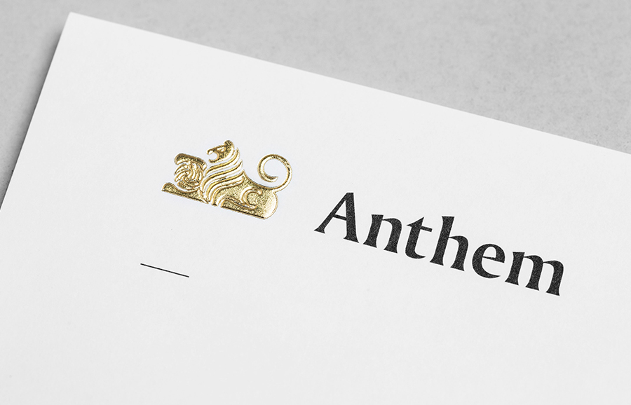 Logo and headed paper with embossed gold foil detail by Anagrama for football scout and transfer business Anthem