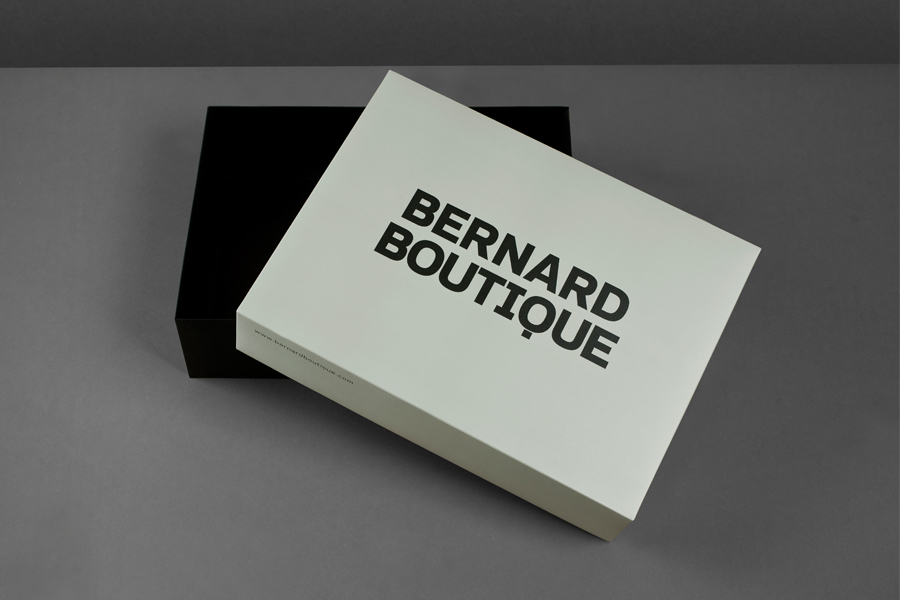 Logo and boxes for award-winning fashion store Bernard Boutique designed by Bunch