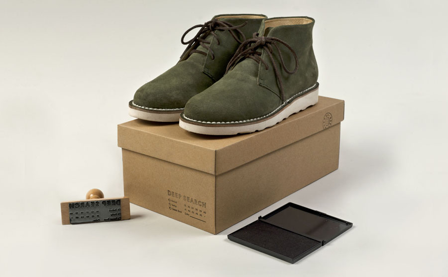 Box with uncoated, unbleached material and stamp detail created by Bielke+Yang for Norwegian shoe brand Deep Search
