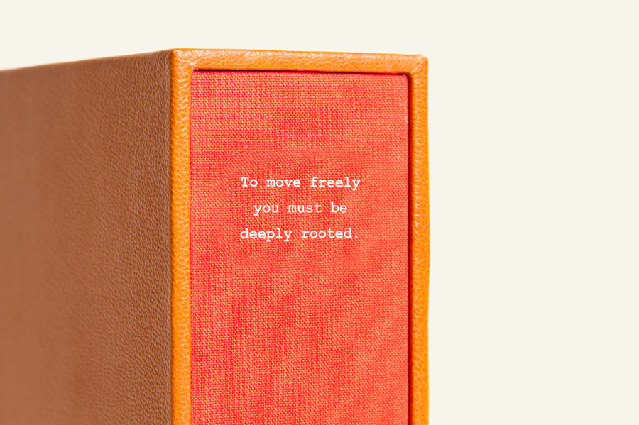 Tan leather and red fabric book packaging for footwear brand Candela designed by RoAndCo