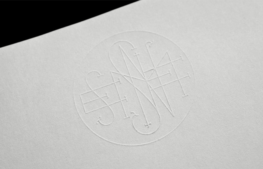 Logo and letterhead with a blind embossed detail designed by Anagrama for Latin American horror film production company Nemesis Films