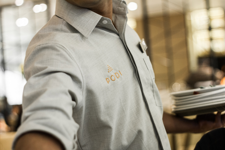 Logotype as a stitched T-shirt detail designed by Bravo Company for Singapore-based organic restaurant Podi