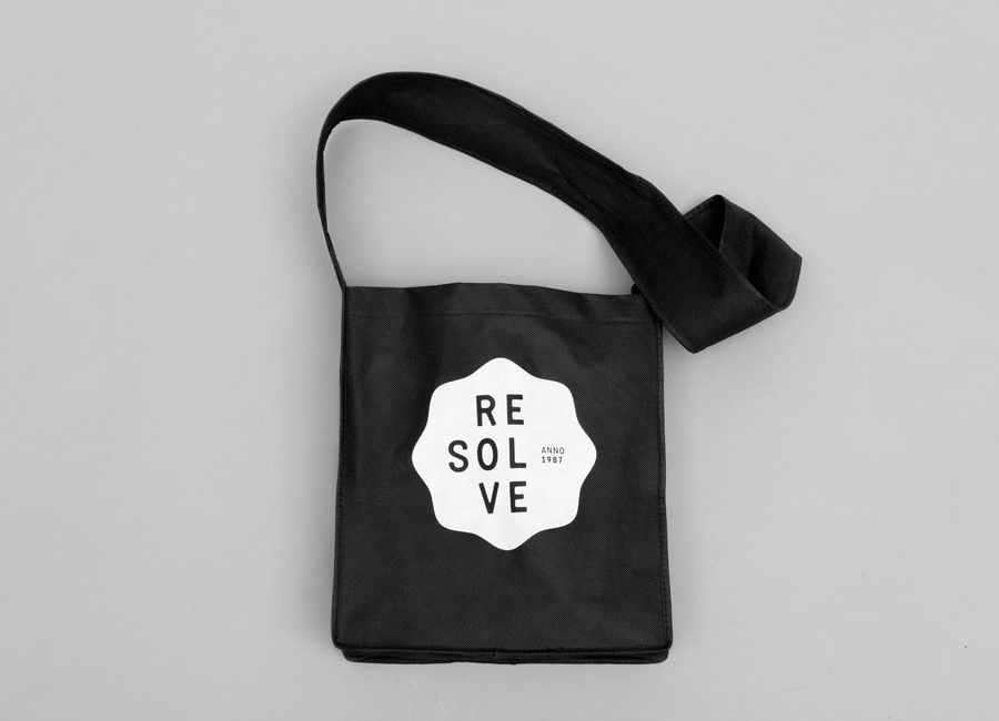 Logo as a white ink print detail across a black bag created by Neue for cleaning and restoration service provider Resolve