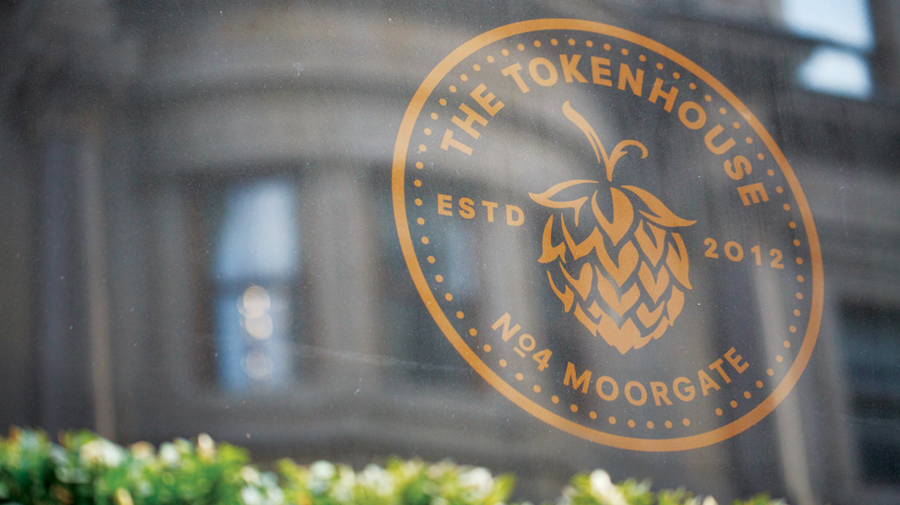 Logo and window decal created by Designers Anonymous for The Tokenhouse