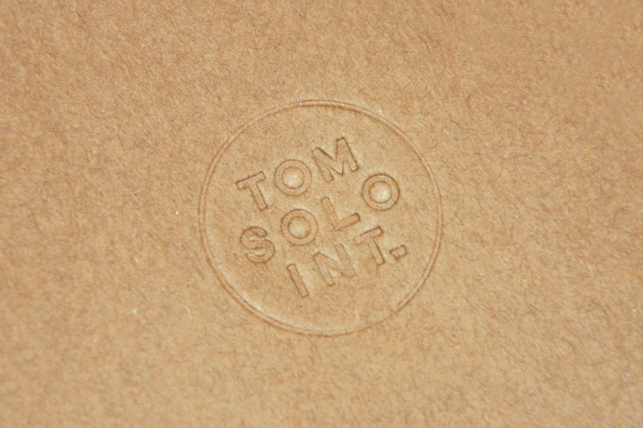 Blind debossed logo for photographer Tom Solo designed by Mash