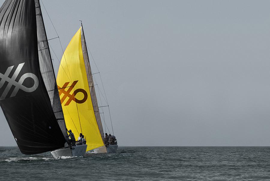 Crosskey logo across boat sails designed by Kurppa Hosk
