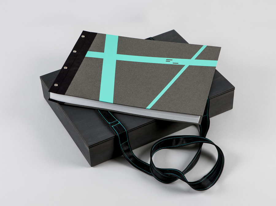 Notebook with fluorescent sticker detail and bike inner tube strap designed by LSDK for Frederik Laux Photography