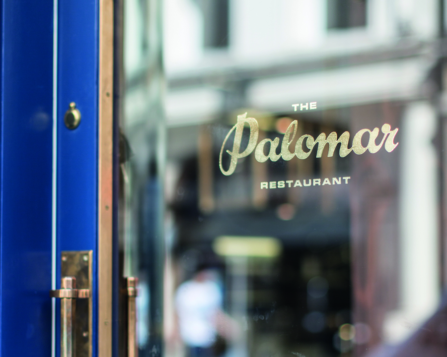 Logotype as gold painted signage designed by Here for Soho restaurant The Palomar