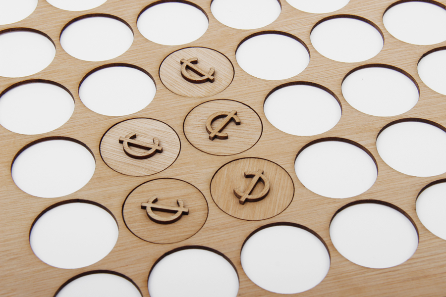 Wooden tokens for craft retail site Cheap Labor designed by Sciencewerk