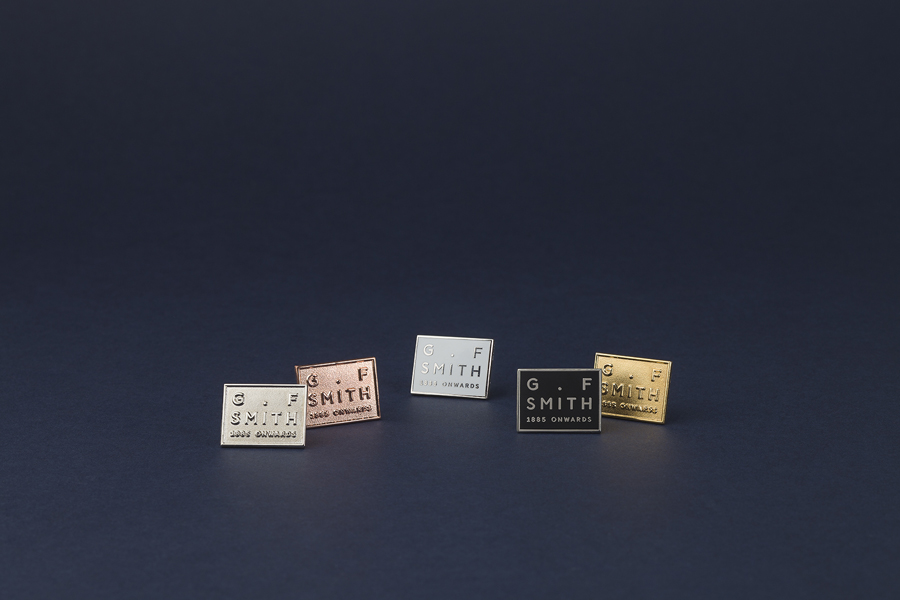 Metal pin badges designed by Made Thought for British paper merchant G . F Smith