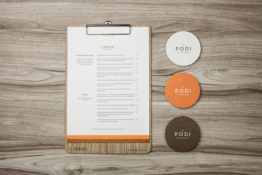Logotype, menu and coasters designed by Bravo Company for Singapore-based organic restaurant Podi
