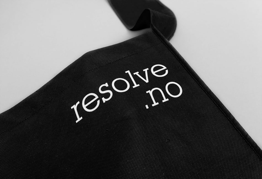 White ink print detail across a black bag created by Neue for cleaning and restoration service provider Resolve