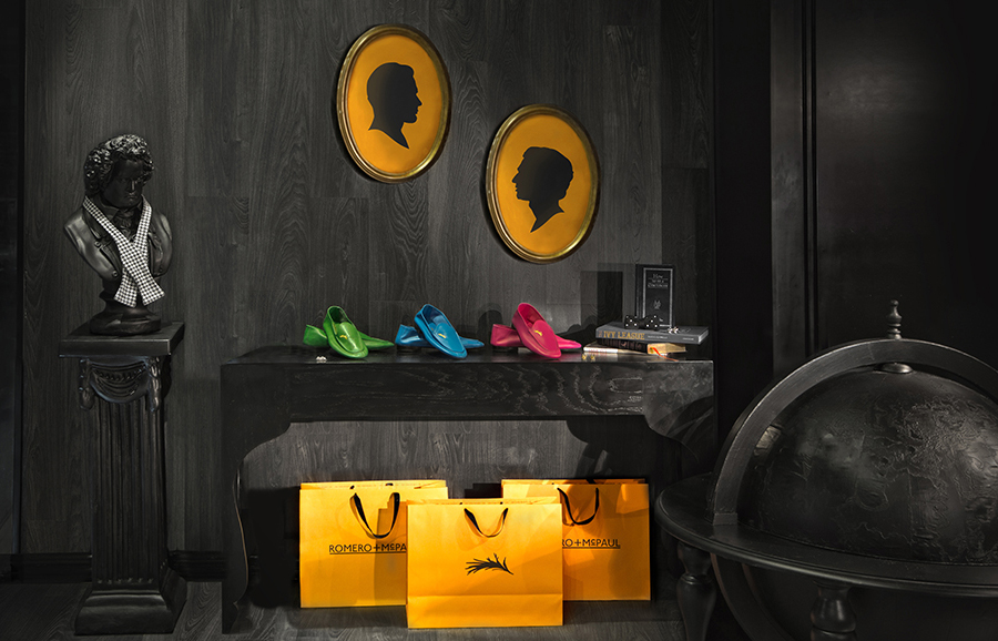 Orange shopping bags created by Anagrama for luxury slipper brand Romero+McPaul