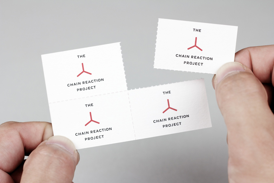 Logo and business card with perforated detail for The Chain Reaction Project designed by Bravo Company