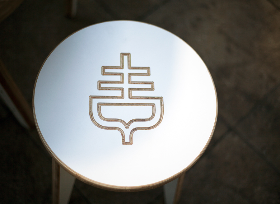 Table with logo cut detail designed by Graphical House for The Empire Café