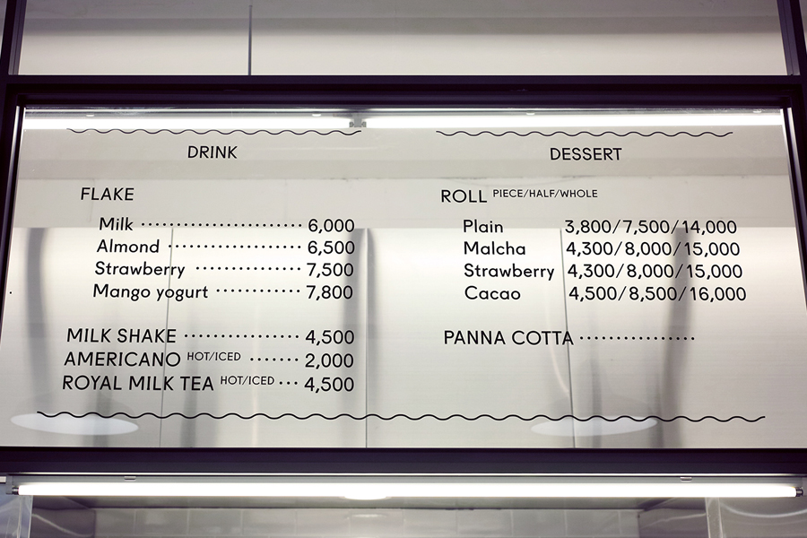 Interior signage designed by Studio FNT for South Korean dessert restaurant Milk Lab