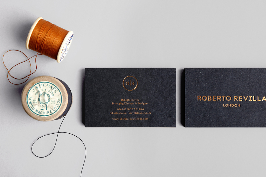 Business card with copper foil finish and mixed fibre board for London based tailor Roberto Revilla designed by Friends