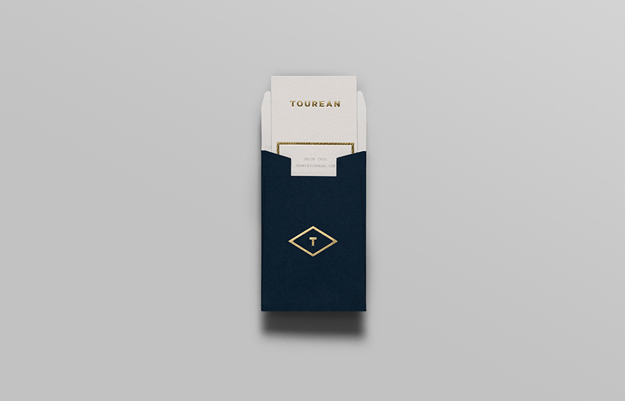 Logotype and business with gold foil detail for British multinational venture capital firm Tourean designed by Anagrama