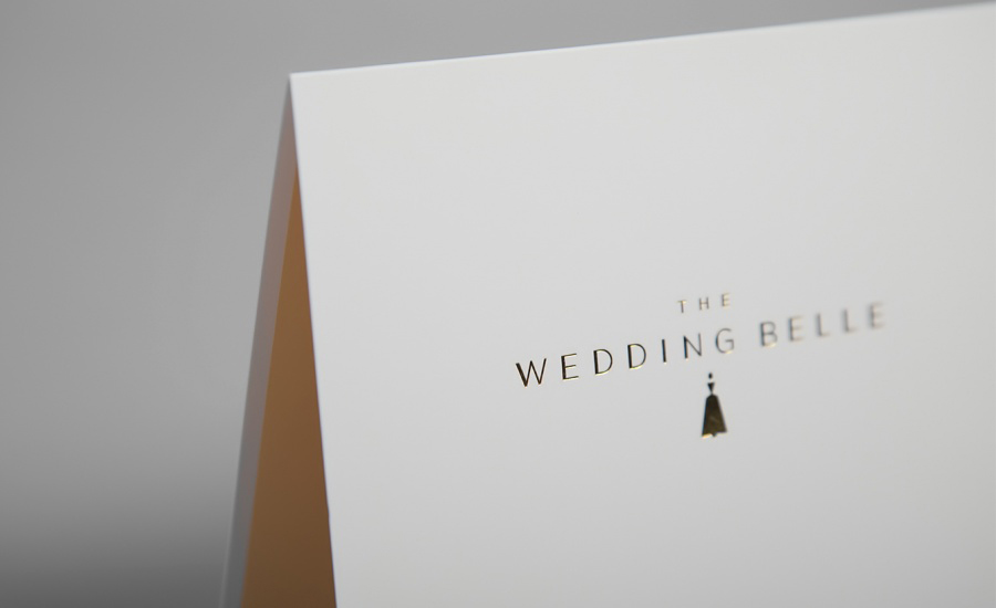 Logo and print with pastel colour and gold foil detail designed by Ghost for wedding planner The Wedding Belle