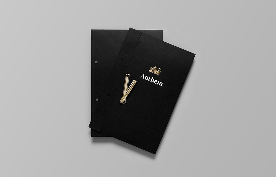 Logo and print with white and gold foil detail by Anagrama for football scout and transfer business Anthem