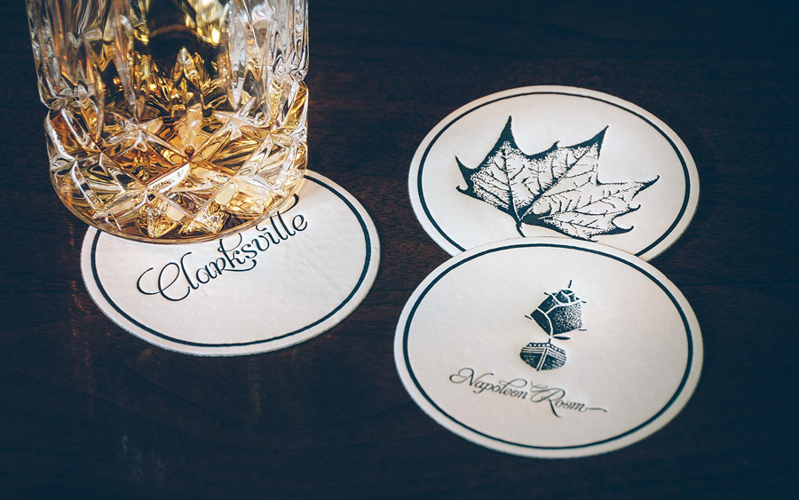 Coasters with stippled botanical illustration by FÖDA Studio for Clarksville fine dining restaurant Jeffrey's.