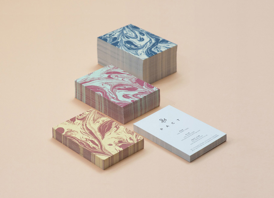 Logo and business card with marble pattern designed by Acre for co-branded retail partnership Pact