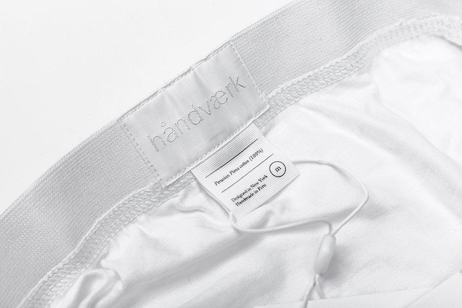 Logotype as a sticked label detail designed by Savvy for fashion brand Handvaerk