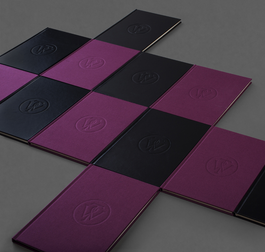 Notepad with purple textile and black leather covers designed by Bunch for business consultancy Willow Tree