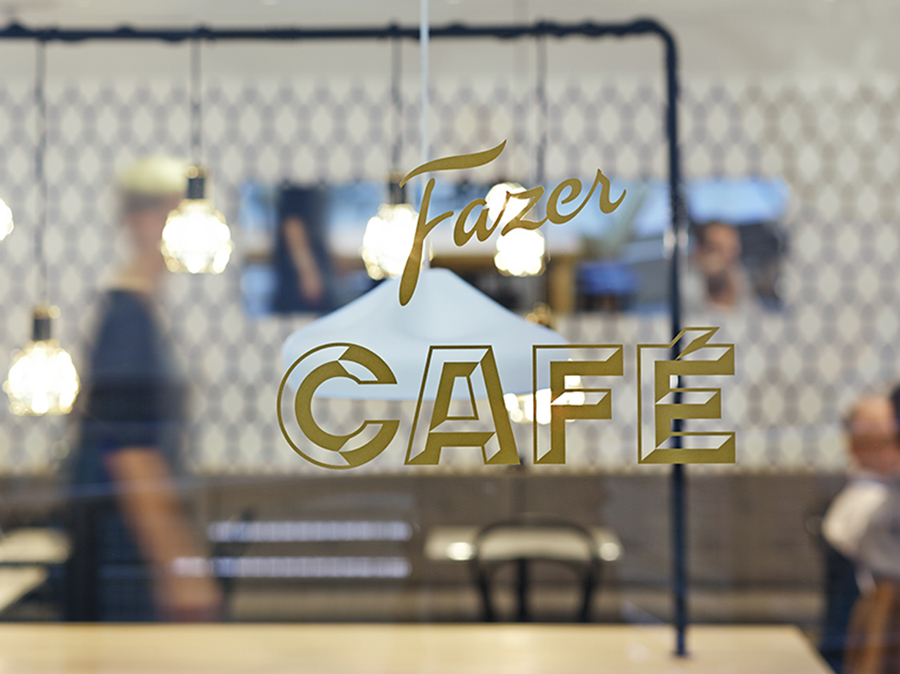 Signage for Helsinki-based Fazer Cafe designed by Kokoro & Moi