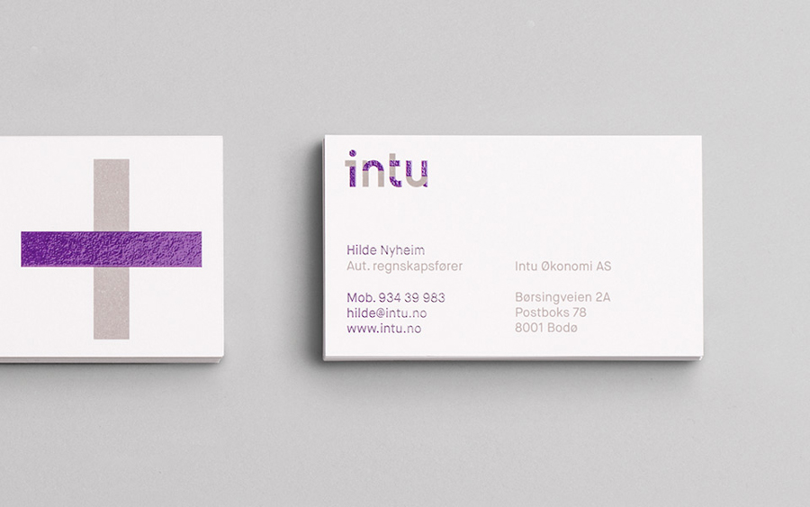 Logotype and business card with a bright purple spot colour detail designed by Heydays for Norwegian accounting and consultant firm Intu