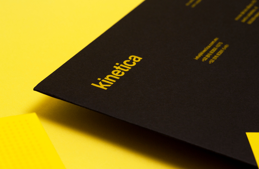 Logotype and folder with yellow ink detail designed by Face for industrial design studio Kinetica