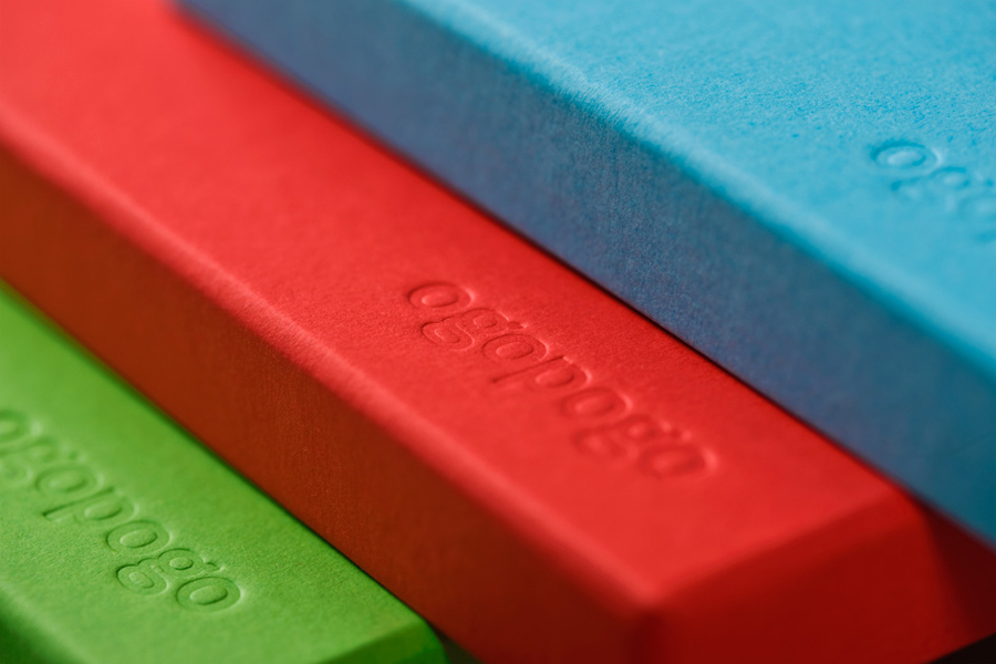 Packaging with blind deboss detail across coloured board for Croatian boxed experience Ogopogo designed by Bunch