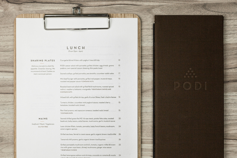 Logotype and menu with wood and fabric detail designed by Bravo Company for Singapore-based organic restaurant Podi