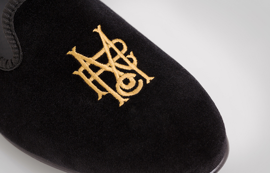 Serif monogram as a gold stitched detail designed by Anagrama for luxury slipper brand Romero+McPaul