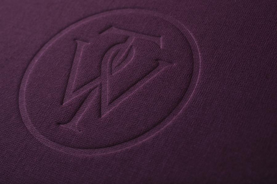 Notebook with purple textile and embossed monogram cover designed by Bunch for business consultancy Willow Tree