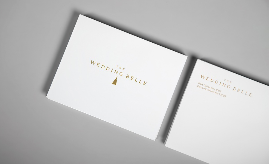 Logo and print with gold foil detail designed by Ghost for wedding planner The Wedding Belle