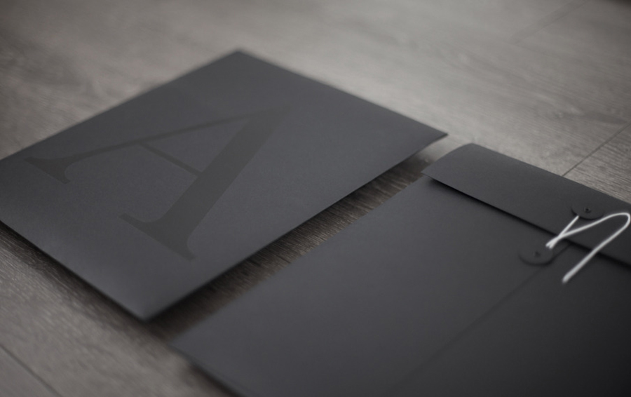 Logo and black folder with a black ink print finish designed by La Tortilleria for home furnishing retailer and interior design service Accents