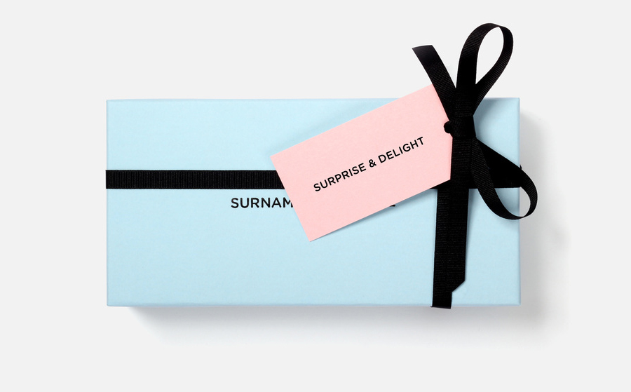 Logo, box and tag designed by NB Studio for consumer focused brand communications agency Surname & Surname