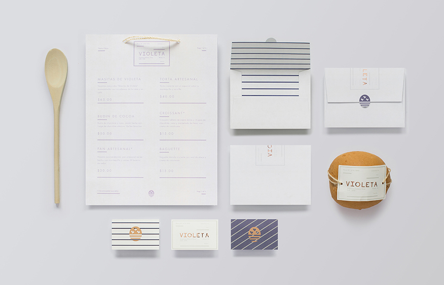 New logo and stationery with copper foil detail designed by Anagrama for traditional Argentinian bakery Violeta
