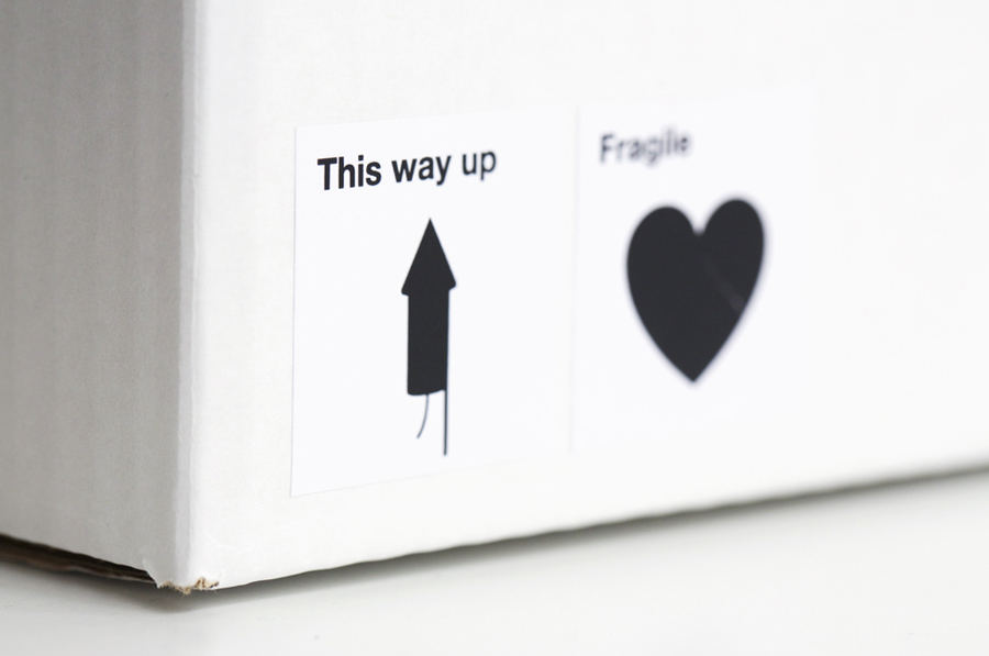 Logo and parcel label with bold icon detail created by Designers Anonymous