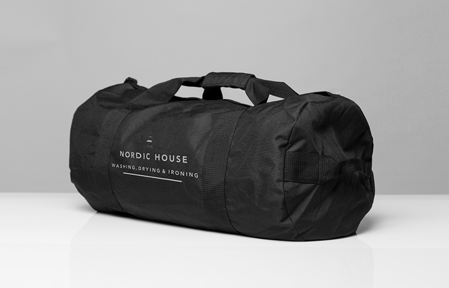 Logo and bag designed by Anagrama for dry cleaning shop Nordic House