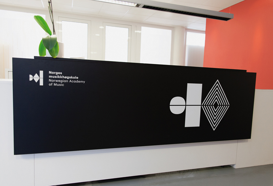 Logo and interior signage for the Norwegian Academy of Music designed by Neue