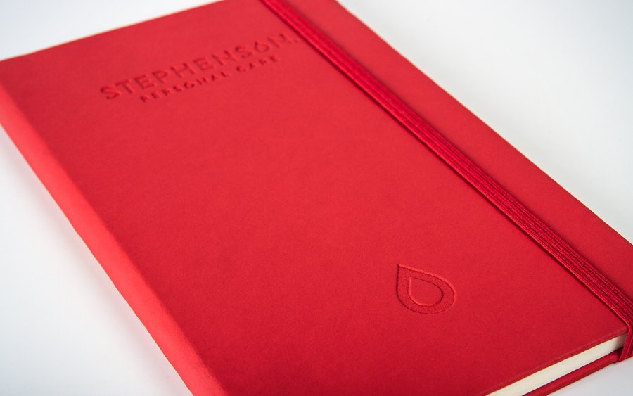 Logo and blind debossed notepad designed by Robot Food for UK soap base specialist Stephenson Personal Care